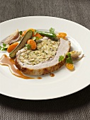 Stuffed roast veal with vegetables