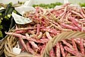 Borlotti beans in a basket on a market stall