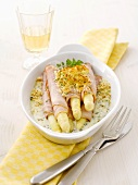 Ham-wrapped white asparagus with gratin topping