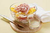 Layered salad with cured pork