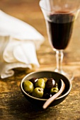 Marinated Kalamata olives and glass of red wine