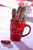 Finger biscuits in a Christmassy mug