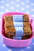 Home-made muesli bars in a plastic box