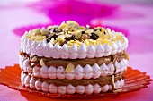 Meringue cake with chocolate filling and almonds