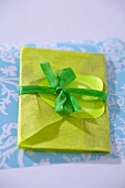 Green envelope with bow