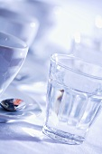 Espresso cups and glasses of water
