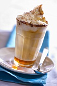 A glass of caffe latte caramel with whipped cream