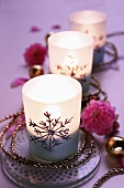 Christmassy tealights with cord and flowers