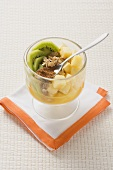 Pineapple, kiwi fruit and walnut starter with cinnamon