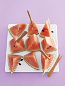 Pieces of watermelon with wooden forks