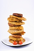 Breaded meat and burgers, stacked