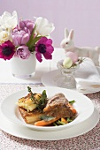 Roast lamb with potato gratin and vegetables for Easter