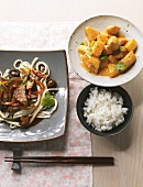 Coconut chicken curry and Far Eastern meat & noodle stir-fry