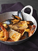 Sea bass with mussels and prawns in pepper and saffron broth