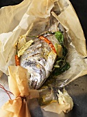 Sea bream with basil and lime cooked en papillote