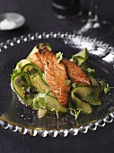 Teriyaki salmon on Japanese cucumber salad