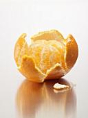 Peeled mandarin orange in its skin