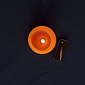 Orange candle (overhead view)