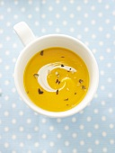 Pumpkin soup in cup from above