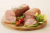Turkey ham, partly sliced with salad and grapes