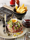 Beef tartare with egg yolk and chips