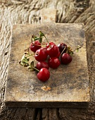 Morello cherries on old chopping board