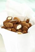 Cinnamon almonds in white container