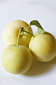 Three Asian pears (also known as nashi pears)