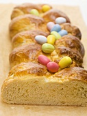 Bread plait with coloured sugar eggs