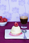 Panna cotta with grated coconut, raspberry and espresso
