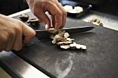 Slicing shiitake mushrooms