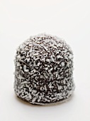 Chocolate teacake covered in grated coconut