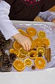 Christmas pot-pourri with dried orange slices etc.