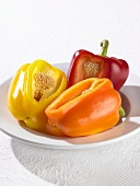 Three peppers, each with a section removed