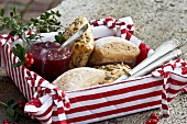 Bread rolls and cranberry jam in a basket