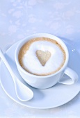 Cappuccino with heart-shaped biscuit