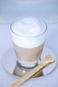 Milky coffee in a glass