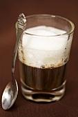 Espresso macchiato with spoon