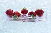 Strawberries frozen in a block of ice