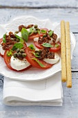 Mozzarella & tomatoes with dried tomatoes, capers, grissini