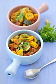 Two bowls of ratatouille with fresh herbs