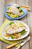 Grilled plaice on broccoli, leeks and yellow beans