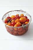 Various types of tomatoes in a steaming basket