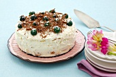 Mandarin coconut cake with whipped cream and chocolate