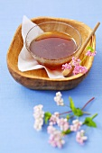 Buckwheat honey in a small dish with flowers