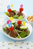 Meatballs with tomatoes and cucumber on cocktail sticks