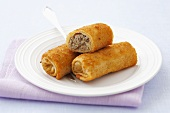 Deep-fried pastry rolls filled with sauerkraut and mushrooms