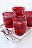 Cherry compote in four glasses