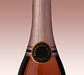 Rosé sparkling wine in bottle (detail)