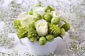 Winter arrangement of white roses, romanesco & Brussels sprouts